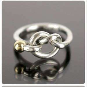 Tiffany & Co twist ring with golden ball.